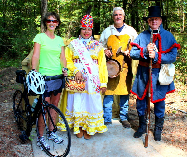Pictured, representing how the new Natchez Trace Boardwalk will benefit the area are: Mina Thorgeson of Ridgeland Tourism (recreation), Choctaw Indian Princess Breanna Layne Issac (culture), Jim Pigott of the Craftsmen's Guild of MS (arts), and Tom Watts of the Natchez Trace Parkway Association (history).