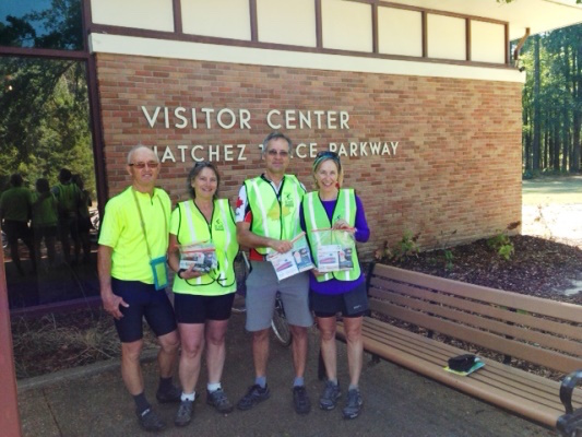Bicyclists receive safety vests and lights at the Headquarters Visitor Center in Tupelo, Mississippi.